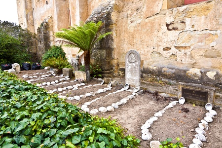 borromeo: cemetery of Carmel Mission   with graves of indians decorated with shells Stock Photo