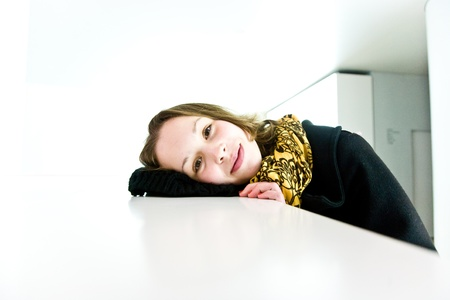 trustful: portrait of an open smiling young girl in a white room Stock Photo