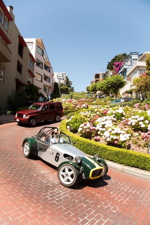 Oldtimer passing the lombard street, san Francisco photo
