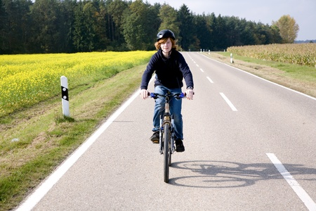 bycicle: young boy on his mountain bike is on a bicycle tour along beautiful countryside Stock Photo