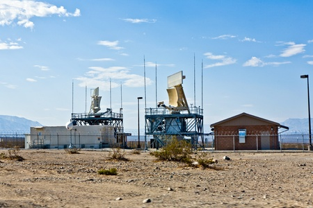 ballarat: BALLARAT, USA - JULY 19: Radar station in the desert near the old ghost town and the Panamint Mountains on July 19, 2008 in Ballarat, USA. This area was in former time a golddigger place.