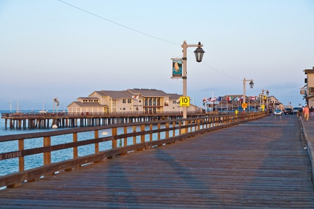 barbara: SANTA BARBARA, USA - JULY 28: people visiting scenic pier in SAnta barbara in sunset  on JULY 28, 2008 in Santa Barbara, USA. First built in 1872, the wharf ranked as the longest deep-water pier. Stock Photo