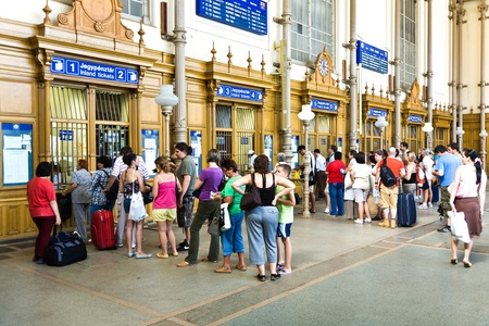 to queue: BUDAPEST, HUNGARIA - AUGUST 04:  people buy tickest in the famous West Train Station in Budapest on August 4, 2008 in Budapest, Hungary. The West Station was constructed by Gustafe Eiffel, the architect of the Eiffel tower in Paris.