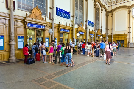queueing: BUDAPEST, HUNGARIA - AUGUST 04:  people buy tickest in the famous West Train Station in Budapest on August 4, 2008 in Budapest, Hungary. The West Station was constructed by Gustafe Eiffel, the architect of the Eiffel tower in Paris.