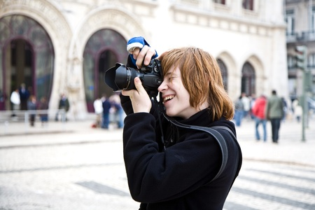 enyoing: young boy likes fotography even when his arm is in blast due to broken hand, he is enyoing Stock Photo