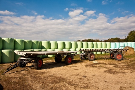 bale of straw infold in plastic film (foil) to keep dry in automn in intensive colors photo