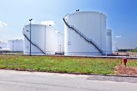 Big white industrial tank with blue sky photo