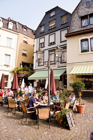 outdoor cafe: market place an frame house from the mediaeval times in romantic Trittenheim at the river Mosel