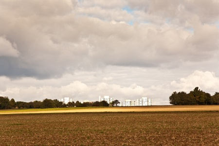 farming area: housing blocks in beautiful landscape in middle of the farming area with beautiful sky