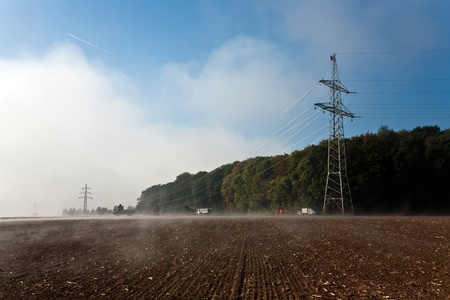 a pylon will be setted up in foggy weather in beautiful landscape with acres in fog Stock Photo - 9888306