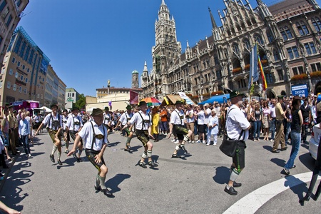 MUNICH, GERMANY - JULY 09 : people celebrate the Christopher Street Day in Munich with colorful costumes  at July 09,2011 in Munich, Germany. It is the worlds biggest party for gay people. Stock Photo - 9891590
