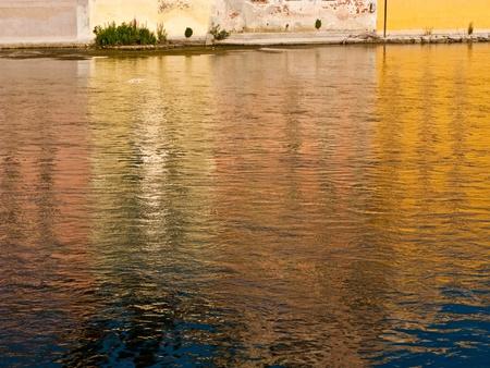 mirroring: colorful mirroring in the river Brenta at the romatntic village Basano del Grappa