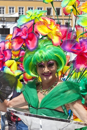 MUNICH, GERMANY - JULY 09 : people celebrate the Christopher Street Day in Munich with colorful costumes  at July 09,2011 in Munich, Germany. It is the worlds biggest party for gay people. Stock Photo - 9914515