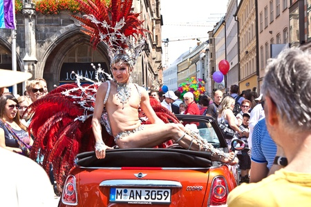 MUNICH, GERMANY - JULY 09 : people celebrate the Christopher Street Day in Munich with colorful costumes  at July 09,2011 in Munich, Germany. It is the worlds biggest party for gay people. Stock Photo - 9914524