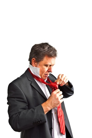 business man binding his tie photo