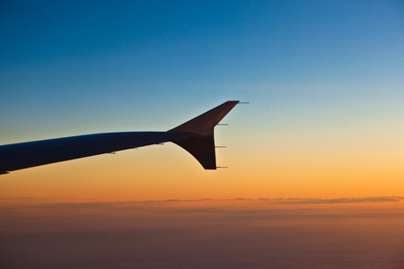 wing of aircraft in sunrise Stock Photo - 9972785