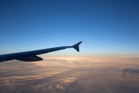 wing of aircraft in sunrise photo