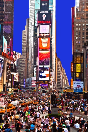 leisure time: view to crowded times square in New York in the evening on July 2010   Editorial