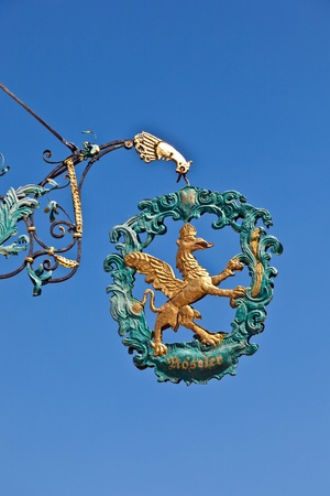 lion and  eagle as sign for an old restaurant in medieval romantic town of Dinkelsbuehl in Bavaria, Germany. Stock Photo - 10006460