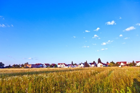 settlement in rural area with fields under blue sky Stock Photo - 9973131