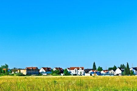 settlement in rural area with fields under blue sky Stock Photo - 9973134