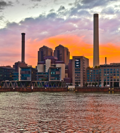 cityview of Frankfurt with river Main and new appartments and office buildings at the riverside at sunset photo