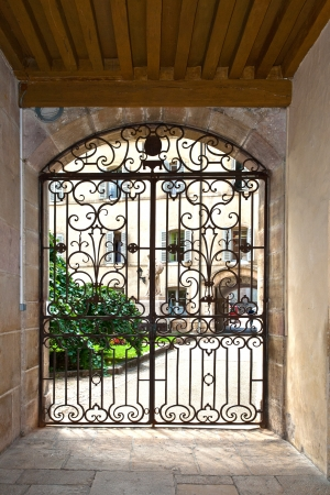 bowsprit: window with iron window grate in famous hospice in Beaune, France Editorial