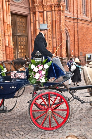 WIESBADEN, GERMANY - 23. JULY:  Marriage of Herbert Berghof and Margitta Martinez  in the famous Marktkirche on July 23,2011 in Wiesbaden, Germany. As chairholder of a stagecoach club stagecoach drivers are invited to the marriage.