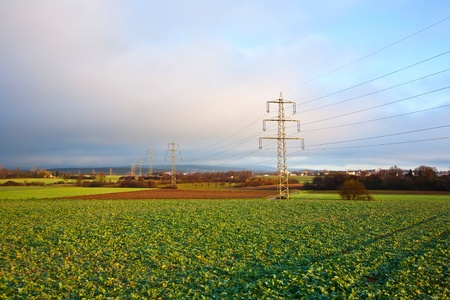 isolator high voltage: electrical tower in landscape with dark clouds Stock Photo