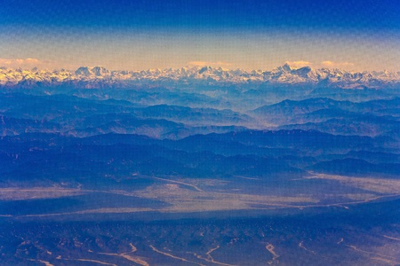 flying over the Himalaya in the morning with sunrise photo