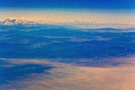 flying over the Himalaya in the morning with sunrise Stock Photo - 10104426