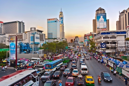 BANGKOK, THAILAND - DEC 22: main road in Bangkok in afternoon traffic jam with cars near the CENTRAL shopping center, Sukhumvit December 22, 2009 in Bangkok, Thailand.