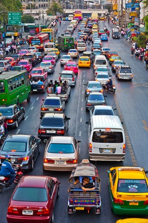 editorial: BANGKOK, THAILAND - DEC 22: main road in Bangkok in afternoon traffic jam with cars near the CENTRAL shopping center, Sukhumvit December 22, 2009 in Bangkok, Thailand. Editorial