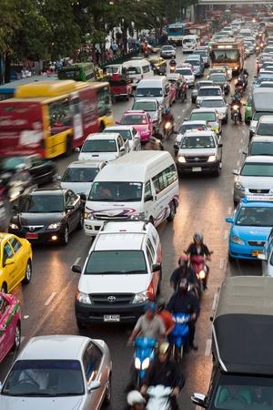 BANGKOK, THAILAND - DEC 22: main road in Bangkok in afternoon traffic jam with cars near the CENTRAL shopping center, Sukhumvit December 22, 2009 in Bangkok, Thailand. Stock Photo - 10123264