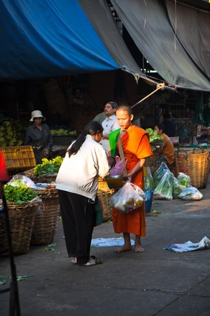 mendicant: BANGKOK, THAILAND - December 23: people donate food to the monk on December 23,2009 in Bangkok, Thailand. Mendicant Monks life by donations from the people and giving to them means good luck for the day.