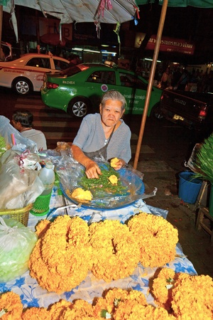 BANGKOK, THAILAND - DECEMBER 23: people selling flowers at Pak Khlong Thalat market on December 23, 2009 in Bangkok, Thailand. The market was invented by King Rama in the late 18th century.