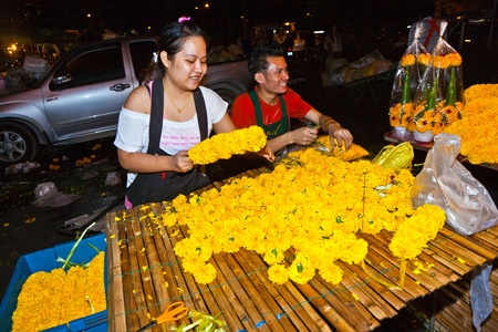 klong: BANGKOK, THAILAND - DECEMBER 23: people selling flowers at Pak Khlong Thalat market on December 23, 2009 in Bangkok, Thailand. The market was invented by King Rama in the late 18th century. Editorial