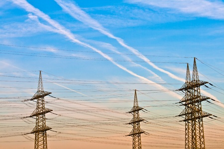 electric power station: electrical tower in landscape with blue sky in sunrise