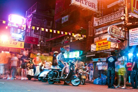 friendliness: BANGKOK, THAILAND - 2 DEC: Traveler and local people have party in the Khao San Road on December 2, 2006 in bangkok, Thailand. Kao San road is the meeting point for all low budget travellers and a24 hour party place.
