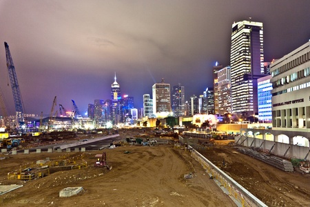 VICTORIA, HONGKONG - JANUARY 07: view during Hong Kong Harbor Laser Show to Skyline of Victoria and a construction site by night on January 07,2010, Victoria, Hongkong. Stock Photo - 10249622