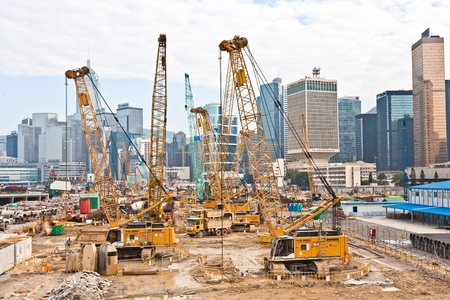 VICTORIA, HONGKONG - JANUARY 09: view to the construction sites near  the harbor of Victoria on January 09,2010, Victoria, Hongkong. They build new skyscrapers and rents are on the top in Hong Kong.