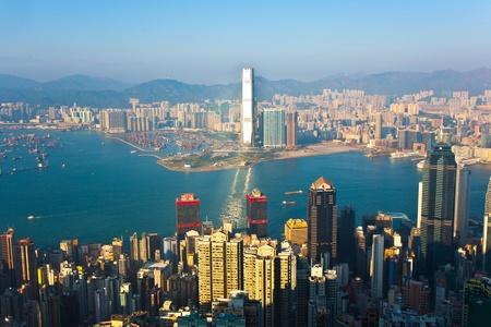 KOWLOON, HONGKONG - JANUARY 9: Hong Kong view from Victoria Peak to the bay and the skyscraper insunset on January 9, 2010, Kowloon, Hongkong. Stock Photo - 10249694