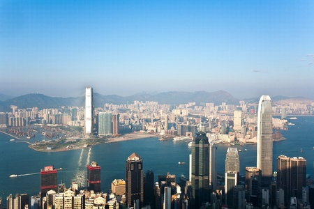 KOWLOON, HONGKONG - JANUARY 9: Hong Kong view from Victoria Peak to the bay and the skyscraper insunset on January 9, 2010, Kowloon, Hongkong. Stock Photo - 10249681
