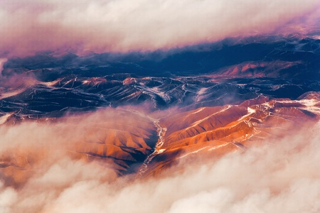 beautiful view from the aircraft to the mountains of the Himalaya on Chinese Tibetan side snow photo