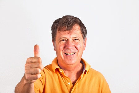 attractive man giving finger sign in the studio Stock Photo - 10283727