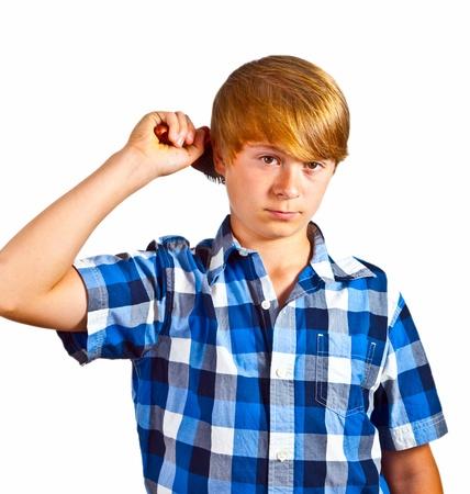 combing hair: young boy brushing his hair Stock Photo