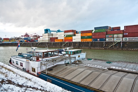 MAINZ, GERMANY - JANUARY 1: ships in container harbor in Winter on January, 1, 2010 in Mainz, Germany. He was constructed by Eduard Kreyssig in 1887 on base of a roman war harbor. Stock Photo - 10274027
