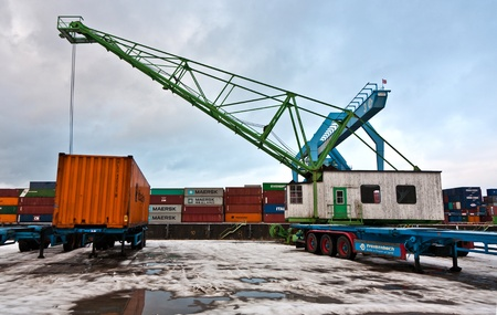MAINZ, GERMANY - JANUARY 1: crane and container in harbor in Winter on January, 1, 2010 in Mainz, Germany. The harbor was build by Eduard Kreyssig in 1887 and the new cranes added in 1961. Stock Photo - 10274009
