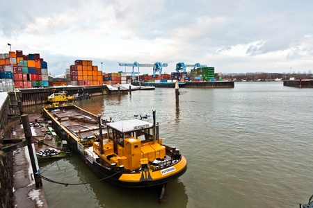 MAINZ, GERMANY - JANUARY 1: ships in container harbor in Winter on January, 1, 2010 in Mainz, Germany. He was constructed by Eduard Kreyssig between 1880 and 1887 on base of a roman war harbor. Stock Photo - 10274040