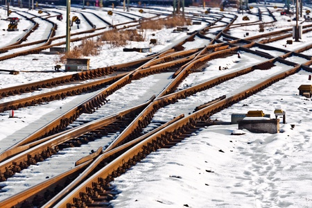 rails in winter at the station photo